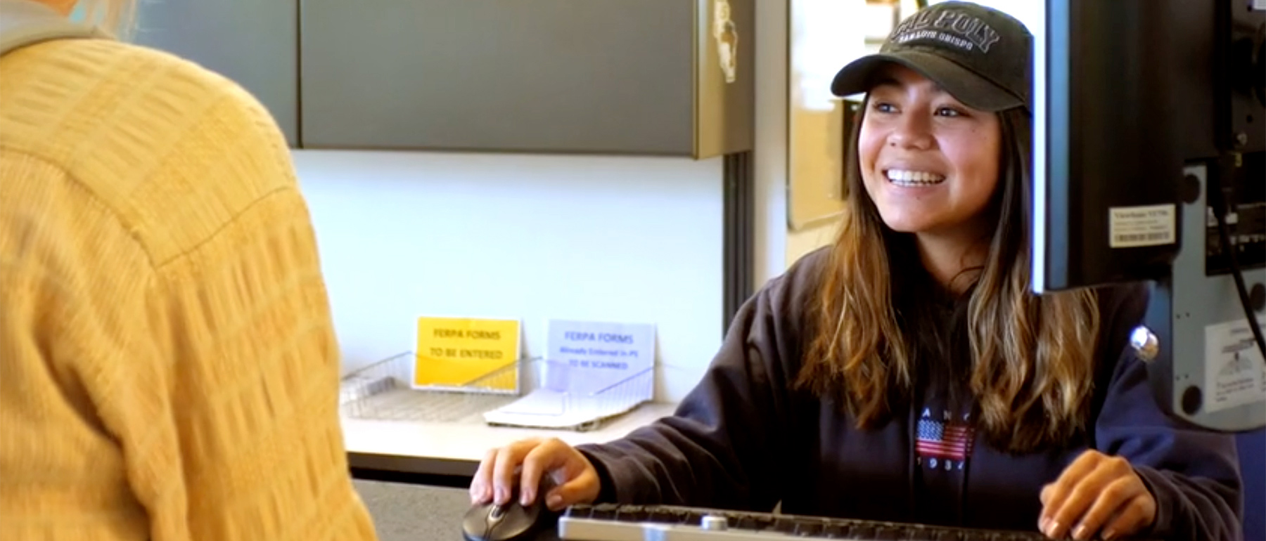 Student at the counter smiling
