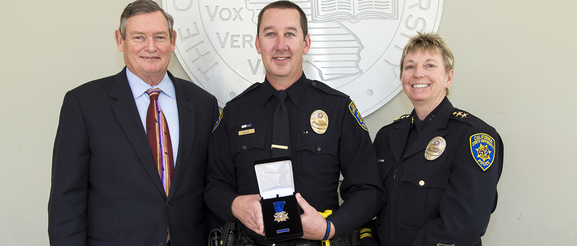 Officer Chad Reiley receives the inaugural CSU lifesaving medal